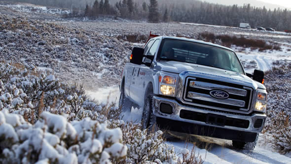 2016 Ford Super Duty driving through snow covered field