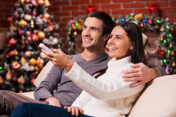 Couple watching TV during Christmas season